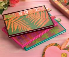 Spray paint over real leaves onto paper to create this set of mini notebooks