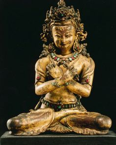 Vajradhara, The Primordial Buddha. Nepal; 15th C. Gilt copper alloy and gems