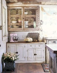 You'd never guess that most of this 1900 cottage was recently built. To add this kitchen, plus a living room, porch, and bathroom, John and Robin scoured the Texas countryside for materials others might overlook--from rusted pressed tin for the ceilings to salvaged windows, doors, and cabinets. #countryliving #kitchens