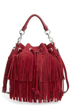 This versatile Rebecca Minkoff bucket bag boasts a fun boho look with swingy, fringed flair and bold crimson color.
