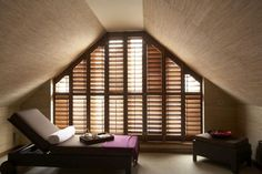 Natural wood shutters from the New England Shutter Company.