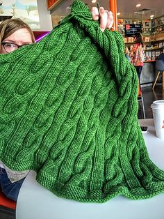The Big Cabled Afghan is easy enough for an adventurous beginner, but its cables (and the prospect of having this warm snuggly blanket beside you all winter long) will keep even an experienced knitter engaged. Written with clear, simple instructions, the 14 row repeat is intuitive and easy to memorize. You can use the directions to easily alter the size or even the shape of the afghan, and can knit it in the pattern yarn (delicious!) or hold a Plucky worsted weight yarn like Trusty double.