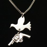 Hand made silver dove and gun  pendant by Pure Brass Neck available at Franny & Filer jewellery shop in Chorlton - www.frannyandfiler.com - £50