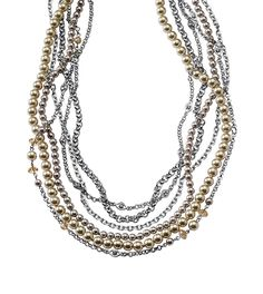 The Juliet, By Jody necklace is rendered in rows of champagne and warm gray resin pearls, mixed with cut crystals and polished silver.