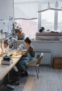 Young woman tailor sewing while sitting at her working place in workshop by Sergey Filimonov - Stocksy United Sewing Room Design, Sewing Spaces, Sewing Studio, Sewing Rooms, Coin Couture, Workshop Design, Workshop Studio, Studio Room, Workspace Design