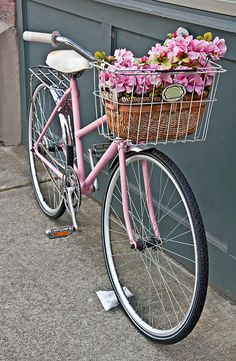 vintage-pink-bicycle-with-pink-flowers https://uk.pinterest.com/uksportoutdoors/dual-suspension-bikes/pins/