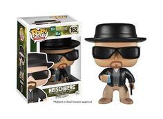 This Breaking Bad Heisenberg Pop! Vinyl Figure features Walter White in his black jacket, dark sunglasses, black hat, wielding a baggie of blue crystals, and a gun. Remember my name!