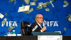 Prankster showers Sepp Blatter with fake dollar bills at Fifa press conference | Football | The Guardian