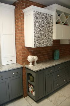 A kitchen I designed using Custom Cupboards line Facets.  You can have anything you wish printed on a flat panel door as long as it does not have a copyright