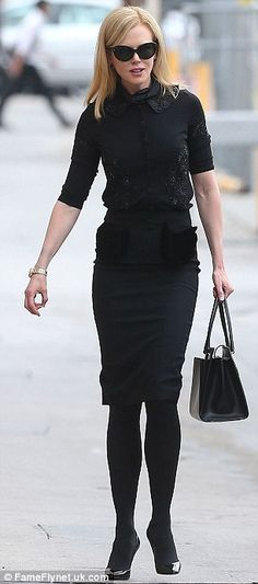 In mourning: The actress wore the same all-black ensemble she wore earlier to the service to farewell her close friend