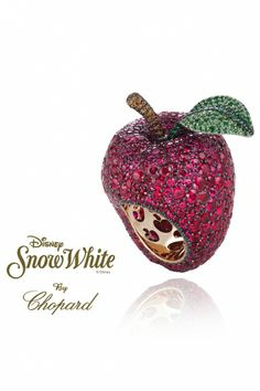 Snow White by Chopard - This apple ring is symbolic of the apple in Snow White and the Seven Dwarves.  Crafted from round-cut rubies for the flesh, the stalk is made up of emeralds, tsavourites and brown diamonds.  -  Disney Princesses-Inspired Jewelry Collection Unveiled at Harrods - DesignTAXI.com