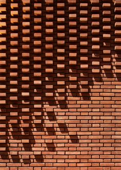 A close up detail of the patterned brick facade Brick Design, Facade Design, Brick Architecture, Architecture Details, Eco Construction, Brick Cladding, Brick Works, Brick Art, Brick Masonry