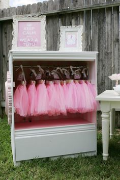 "Tutu Display: At this teacups and tutus birthday party, ""each little girl received a personalized tote bag for their tutu, crafts, tulle wand, jewels, and sweets,"" says Johanna Saucier, mom to the little birthday girl. We especially love the tutus, displayed in a vintage wardrobe, topped with a ""keep calm and wear a tutu"" sign.  Source: CN Photography"