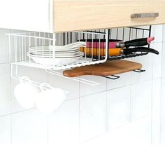This under cabinet organizer is brilliant for storing plates chopping boards and pans Spice Rack Organization, Kitchen Sink Organization, Sink Organizer, Wall Organization, Organizing Ideas, Organizing Solutions, Under Shelf Basket, Basket Shelves, Extra Storage Space
