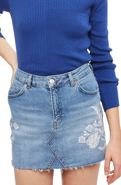 This cutoff denim miniskirt with rose embroidery is the perfect combo of flirty + cool