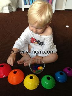 Practice shape sorting with Pom Pom and other little objects