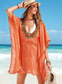 I was in love this caftan cover up!  Sadly, it's definitely meant for a longer leaner lady than myself...  Being short & squatty, it looked like a giant mumu on me so I'll be returning it.