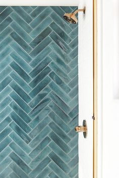 Contemporary bathroom boasts a walk-in shower with a glass enclosure, gold trim,. - Contemporary bathroom boasts a walk-in shower with a glass enclosure, gold trim, and a stunning blu - Shower Tile Designs, Walk In Shower Designs, Shower Tiles, Wood Tile In Shower, Gold Shower, Bathroom Designs, Patterned Wall Tiles, Wall Patterns, Bathroom Tile Patterns
