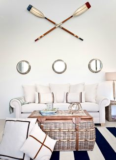 Nautical Porthole Mirrors with Oar Gallery Wall: http://www.completely-coastal.com/2015/03/nautical-porthole-mirror-gallery-wall.html