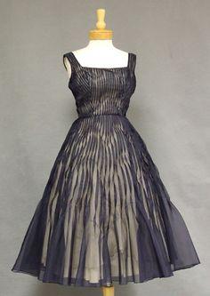 Vintageous, LLC - UNIQUE Twisted Pintucked Navy 1950's Cocktail Dress, $265.00 (http://www.vintageous.com/unique-twisted-pintucked-navy-1950s-cocktail-dress/)