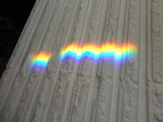On a sunny day, I find rainbows all over the living room since I hung prisms in the window.