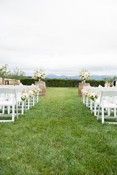 Gorgeous creams, whites, greens, and peaches in the florals topping the wine barrel alter background