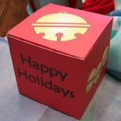 Craft project: Instructions and patterns for making small gift boxes for Christmas-cube shaped and collapsible. Can be used as ornaments and as packages under little Christmas trees.