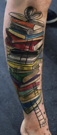 Stack of books tattoo (by Fabio Moro at Morotattoos)