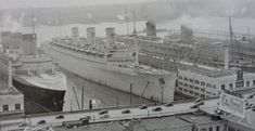 For just fourteen days between 7th and 21st March 1940, the world's three  largest liners were together at New York. They are (left to right)  the NORMANDIE, the QUEEN MARY and the QUEEN ELIZABETH.   The world's three largest liners were together for the first and, as events were to prove, the last time.