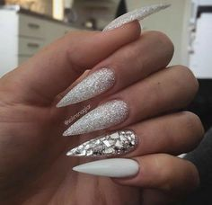 Stiletto Nails. White Nails. Silver Nails. Glitter Nails. Acrylic Nails. Gel Nails
