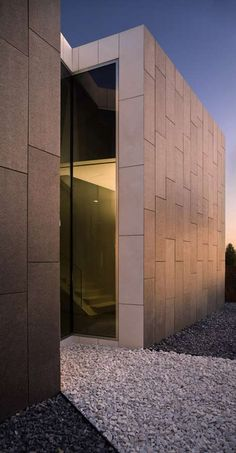This house in Barcelona by architect Santiago Parramón of RTA-Office is clad in slabs of basalt. #Architecture