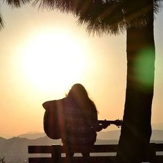 Αχ αυτή η αγάπη στα κενά την περιμένω και μου έρχεται σα Μι. (p.n.) #InP #photography #poetry #sunset #romance #guitar #mellody #song #love #miracle #luck #special #heart Image N, Poetry, Silhouette, Celestial, Sunset, Photo And Video, Videos, Outdoor, Instagram