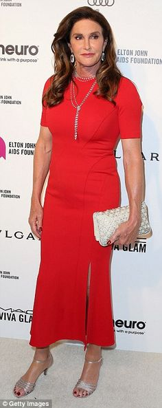 Diva time: Caitlyn Jenner, in scarlet red, and Mariah Carey, in revealing black, both showed up to watch the Academy Awards at Elton John's annual viewing party in Hollywood