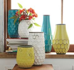 Honeycomb vases in teal, chartreuse, and white.