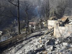 Remains of homes smolder on Tuesday, Nov. 29, 2016,