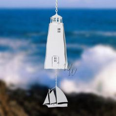 20% off Sale! Get our beautiful North Country Sailor Lighthouse Bell W/White Sailboat Windcatcher for $57.98 (originally $75.60). || whimsicalwinds.com || #windchimes #whimsicalwinds #lighthouse #sailboat Wind Chimes, Wind Turbine, North Country, Beach Themes, Sailboat, Lighthouse, Whimsical, Beautiful, Sailing Boat
