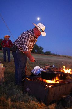 The moon goes down, the sun comes up, and volunteers are already making breakfast for the cattle drive.
