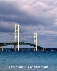 A sleek suspension bridge spans the Straits of Mackinac, Michigan.  I've crossed this bridge so many times…and whenever I do, I know that once I'm in the UP, I've gone to heaven.