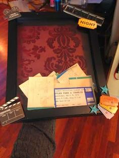 Movie ticket shadow box.  So easy to make and inexpensive.