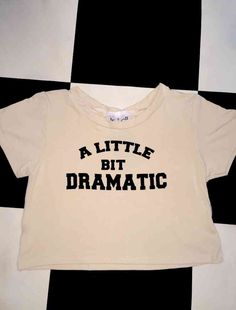 A little bit DRAMATIC Just a little bit... :-)  Cotton spandex blend All over stretch Round neck cropped tee