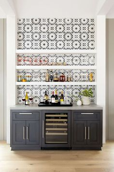 Opt for graphic tiles: Cement tiles from Ann Sacks, installed behind the Thermador gas cooktop and the dry bar beside the dining table, add the right amount of focal-point pattern. Click through for more amazing photos of this farmhouse kitchen. Outdoor Kitchen Bars, Home Bar Designs, Wet Bar Designs, Dining Room Bar, Dining Table, Dining Room Floating Shelves, Wall Bar, Wall Décor, Wall Tiles