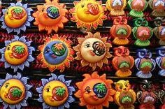 smiling suns, traditional handmade handycraft from Metepec, México.