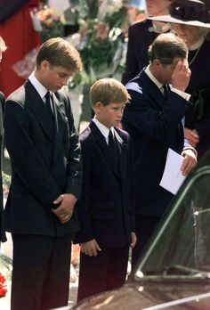 Prince William, Prince Harry and Prince Charles mourn at Princess Diana's funeral in 1997.