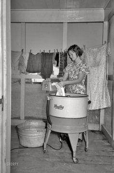 September 1938. Farm wife washing clothes. Lake Dick Project, Arkansas. 35mm negative by Russell Lee, Farm Security Administration. jmusky11