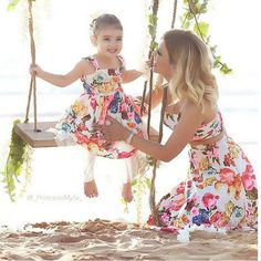 What a sweet picture and the mommy daughter dresses are perfect