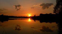 The sunset on the Sadská lake, near town Sadská, region Nymburk, country Czech Republic,
