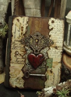 Great idea for a sketchbook or journal cover using burned edges on post cards, love letters, or sheet music.