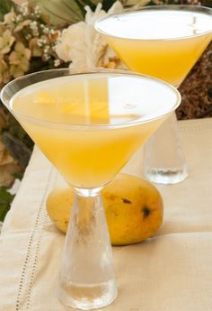 """Mango Martini: 50 grams/ Ruby Red Vodka 50 Mango Vodka lemon, freshly squeezed 1 mangos muddle or puree splash fresh squeezed orange juice.variation: """"nectarine martini"""" - vodka, peach schnapps, orange juice and a dash of mango puree Mango Martini, Mango Vodka, Mango Drinks, Vodka Drinks, Refreshing Drinks, Summer Drinks, Fun Drinks, Alcoholic Drinks, Martinis"""