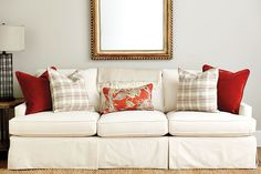 Spicy orange throw pillows on a sofa