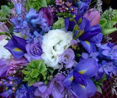 Purple/Blue/Cream mixed wedding flowers for displays and centerpieces with crystal type vases (non fragrant ones).